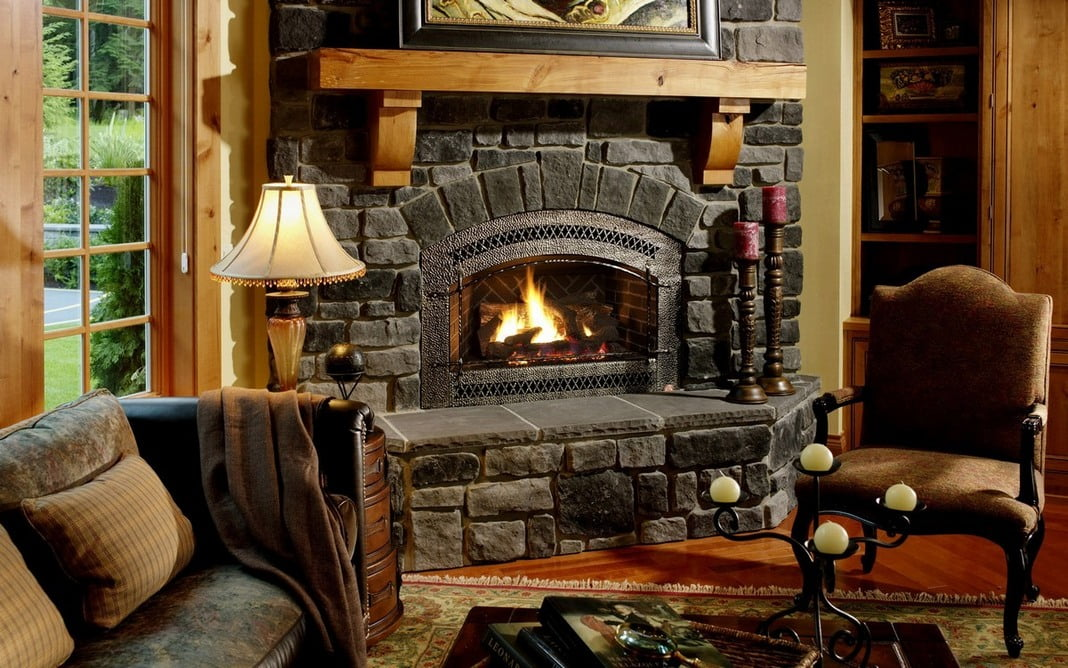 antient-style-corner-fireplace-stone-facing-with-sconces-and-candles