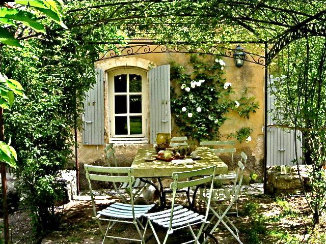 outdoor dining cafe chair pergola shutters French Provence