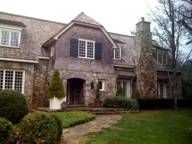 fantastic-rock-exterior-wall-plus-oversized-topiary-entrance-decor-idea-and-creative-gambrel-roof-house-657x493